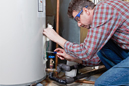 Plumber fixing a Water Heater